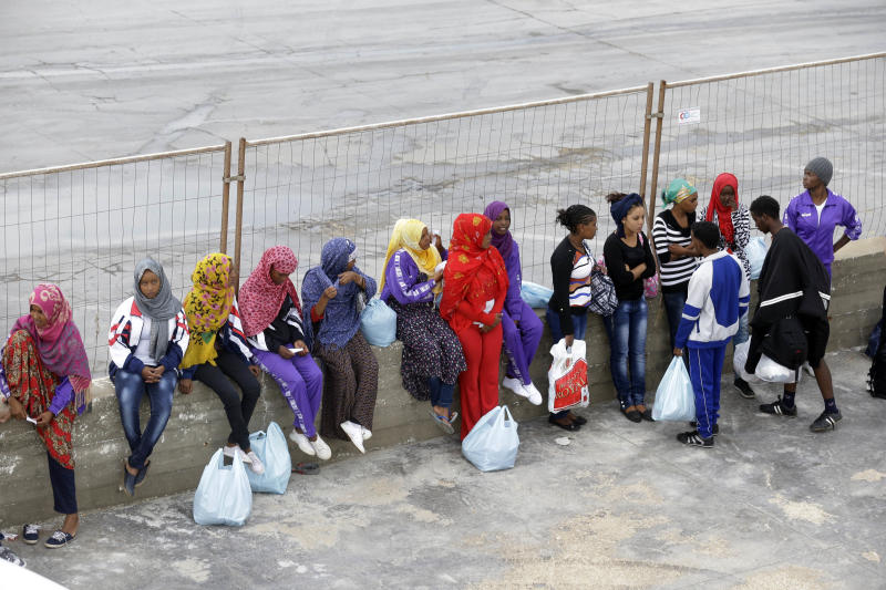 Migrants wait to board a ferry boat from the port of Lampedusa, for Sicily, southern Italy, where they will be sent to other temporary camps based on their legal status, Monday, Oct. 7, 2013. On Thursday a fishing boat packed with 500 African migrants capsized off the shores of the island of Lampedusa, causing at least 190 dead and more than 100 missing in what could become the largest death toll in a migrant shipwreck in the Mediterranean on record. Laura Boldrini, the speaker of Italy's lower house who recently led a parliamentary delegation to Lampedusa, said the migrants who are reaching Europe's shores now are by and large asylum seekers, not economic migrants, as has been the case in the past, and that European countries need to align their immigration policies. (AP Photo/Luca Bruno)