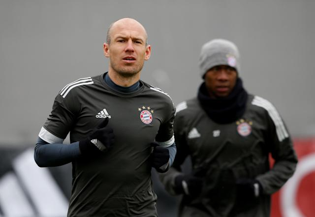 Soccer Football - Champions League - Bayern Munich Training - Saebener Strasse Training Ground, Munich, Germany - February 19, 2018 Bayern Munich's Arjen Robben and David Alaba during training REUTERS/Michaela Rehle