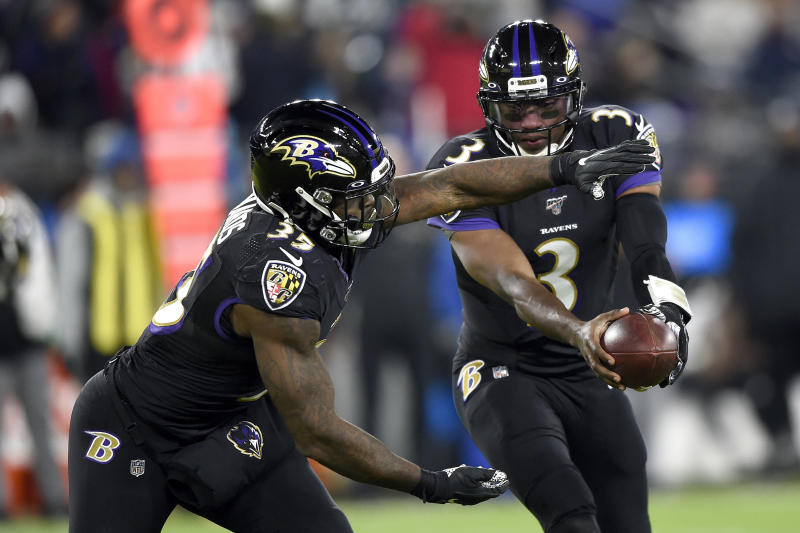 FILE - In this Dec. 12, 2019, file photo Baltimore Ravens quarterback Robert Griffin III (3) prepares to handoff to running back Gus Edwards (35) during the second half of an NFL football game against the New York Jets in Baltimore. It will be Griffin's first NFL start since 2016 on Sunday, Dec. 29. (AP Photo/Gail Burton, File)
