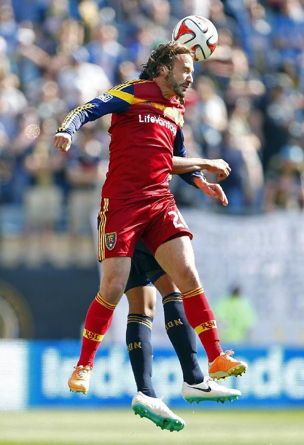 Real Salt Lake's Ned Grabavoy (20) heads the ball away from Philadelphia Union's Sheanon Williams (25) during the first half during an MLS soccer match at PPL Park in Chester, Pa., Saturday, April 12, 2014. (AP Photo/Rich Schultz)