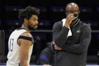 Chicago State head coach Lance Irvin, right, reacts as he looks at forward Aaris-Monte Bonds during the first half of an NCAA college basketball game against Northwestern in Evanston, Ill., Saturday, Dec. 5, 2020. (AP Photo/Nam Y. Huh)