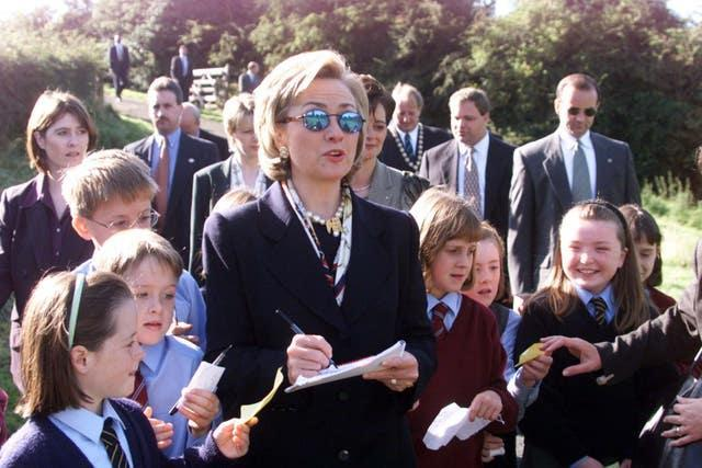 Hillary Clinton, then the first lady, signs autographs for children, during a visit to Lagan Meadows, Belfast (Jeremy Selwyn/PA)