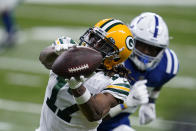 Green Bay Packers wide receiver Davante Adams (17) makes a catch during the first half of an NFL football game against the Indianapolis Colts, Sunday, Nov. 22, 2020, in Indianapolis. (AP Photo/Michael Conroy)
