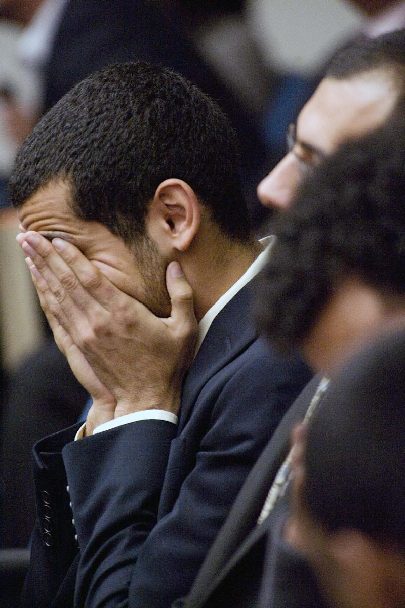 One defendants covers his face before the jury found the 10 Muslim students guilty of disrupting the Israeli ambassador's university speech about U.S.-Israel relations, a case that stoked a debate about free speech, Friday, Sept. 23. 2011 in Santa Ana, Calif. (AP Photo/Orange County Register, Ken Steinhardt)   MAGS OUT; LOS ANGELES TIMES OUT