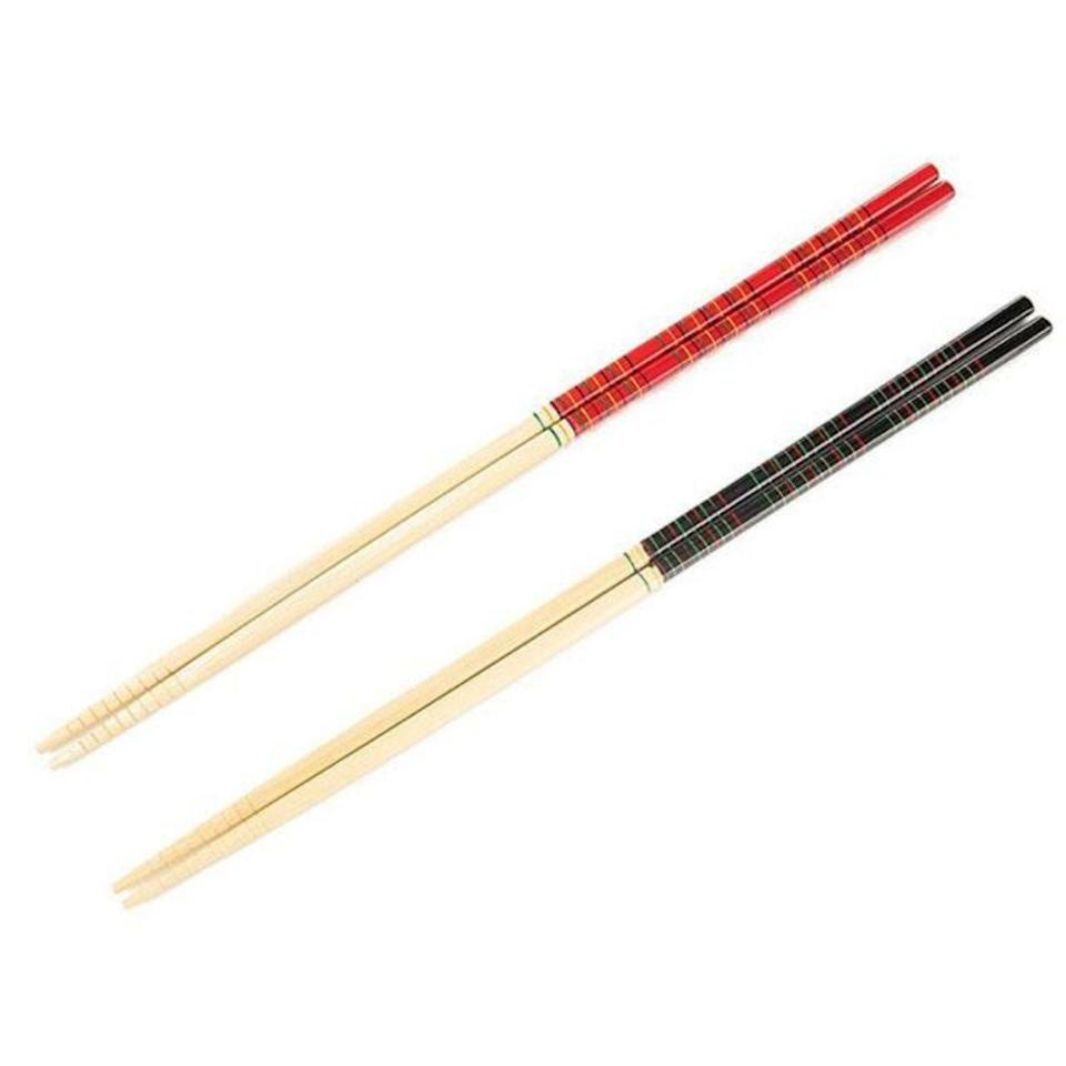 """<p><strong>Kitchenware</strong></p><p>pearlriver.com</p><p><strong>$1.95</strong></p><p><a href=""""https://pearlriver.com/collections/kitchenware-chopsticks/products/14792"""" rel=""""nofollow noopener"""" target=""""_blank"""" data-ylk=""""slk:Shop Now"""" class=""""link rapid-noclick-resp"""">Shop Now</a></p><p>These extra-long cooking chopsticks from New York City institution, Pearl River Mart, will <strong>help keep your hands and arm safe from heat and food splatter.</strong> The 13-inch long style allows for some distance while still allowing you to cook. They are made of bamboo and also have a ring pattern at the tips to help flip or grip food. </p>"""