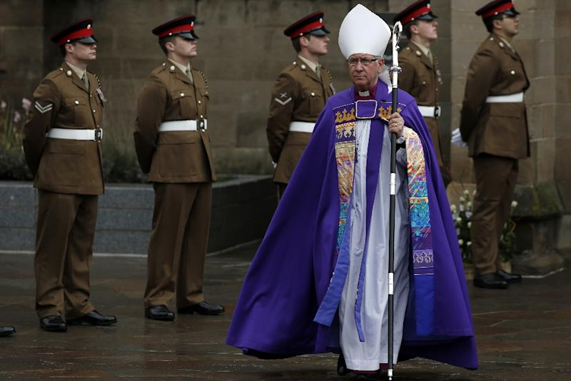 The Right Reverend Tim Stevens, Bishop of Leicester, arrives at Leicester Cathedral ahead of a service of reinterment for England's King Richard III on March 26, 2015 (AFP Photo/Adrian Dennis)