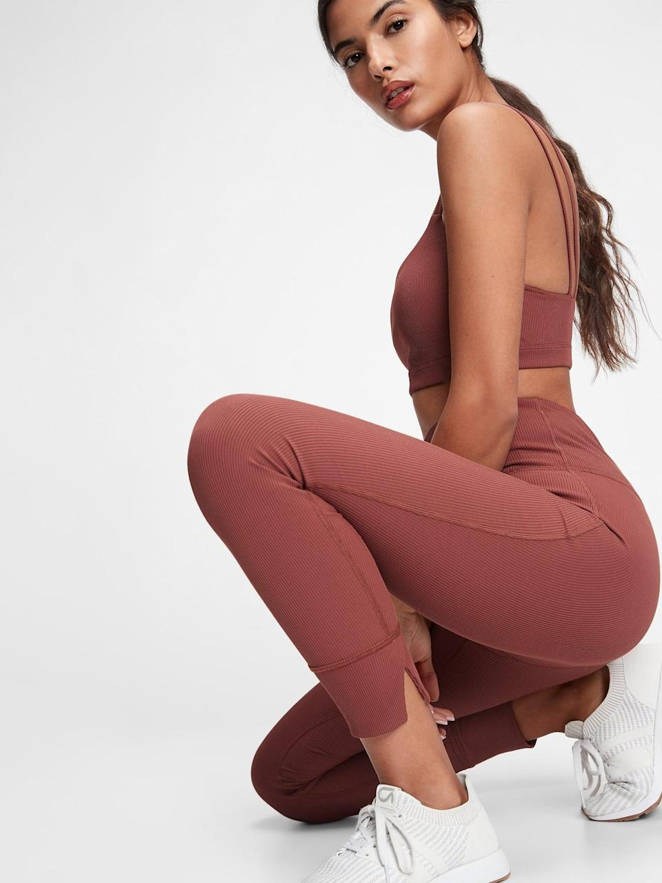 <p>Whether you're into a terracotta or chocolate shade, brown is the versatile neutral we need right now. It manages to be warm, inviting, and elegant all at the same time. We love the look of this <span>GapFit High Waisted Ribbed Blackout Leggings</span> ($54, originally $60) and matching <span>Blackout Ribbed Low Impact Sports Bra</span> ($31, originally $35).</p>