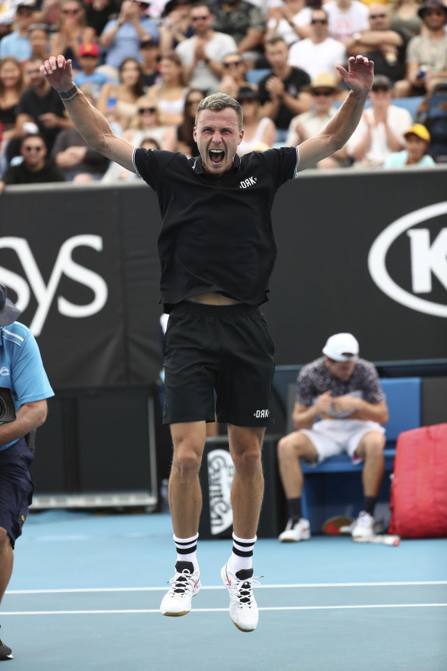 Hungary's Marton Fucsovics celebrates after defeating Tommy Paul of the U.S. in their third round match at the Australian Open tennis championship in Melbourne, Australia, Friday, Jan. 24, 2020. (AP Photo/Dita Alangkara)