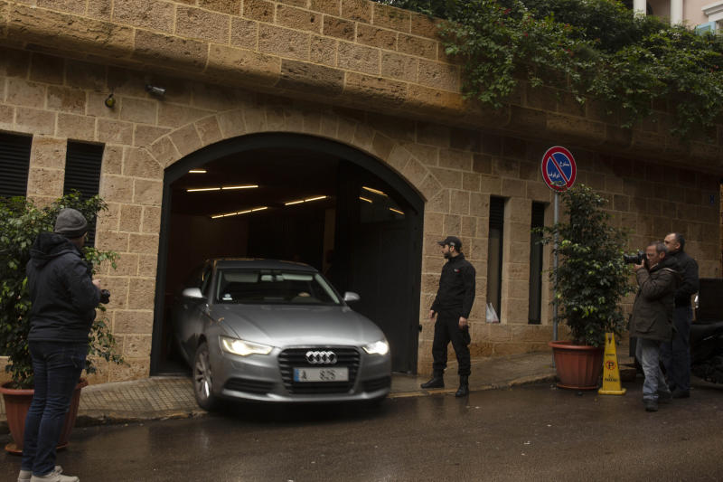 A vehicle leaves the house of ex-Nissan chief Carlos Ghosn in Beirut, Lebanon, Saturday, Jan. 4, 2020. Ghosn earlier this week jumped bail in Japan and fled to Lebanon rather than face trial on financial misconduct charges in a dramatic escape that has confounded and embarrassed authorities. (AP Photo/Maya Alleruzzo)