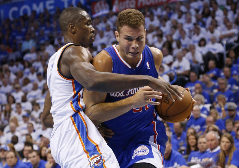 Los Angeles Clippers forward Blake Griffin, right, drives against Oklahoma City Thunder forward Serge Ibaka in the first quarter of Game 2 of the Western Conference semifinal NBA basketball playoff series in Oklahoma City, Wednesday, May 7, 2014. (AP Photo/Sue Ogrocki)