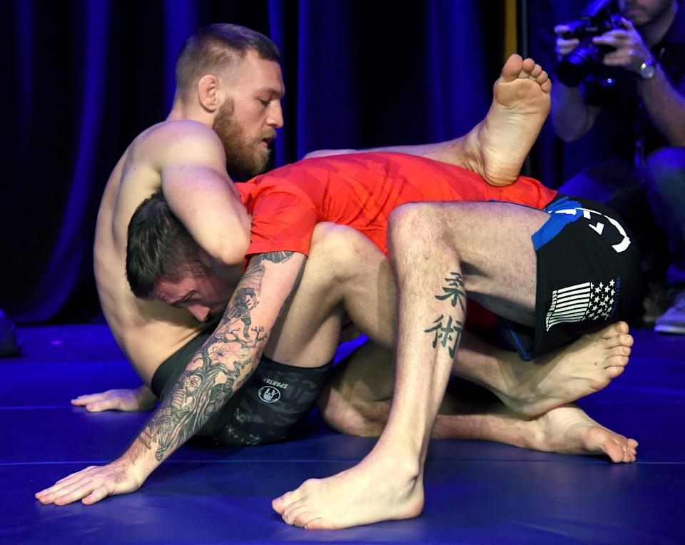 John Kavanagh and Conor McGregor at the open workouts ahead of UFC 202 in 2016Getty Images