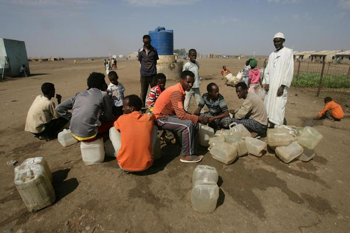 Eritrean refugees sit in Shagarab refugee camp in Sudan, which receives about 2,000 asylum-seekers every month -- largely from neighbouring Eritrea -- where many have fled military service, January 12, 2012 (AFP Photo/Ashraf Shazly)