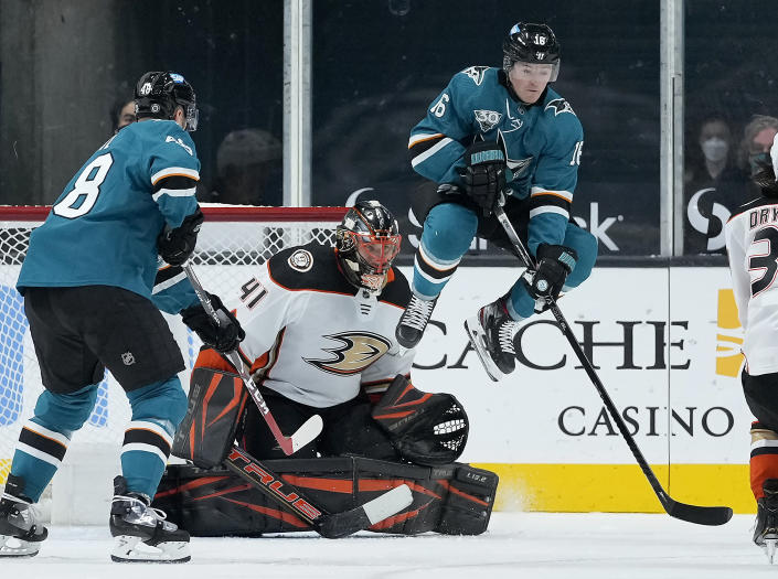 San Jose Sharks center Ryan Donato (16) leaps out of the way as Anaheim Ducks goaltender Anthony Stolarz (41) makes a save during the second period of an NHL hockey game, Monday, April 12, 2021, in San Jose, Calif. (AP Photo/Tony Avelar)