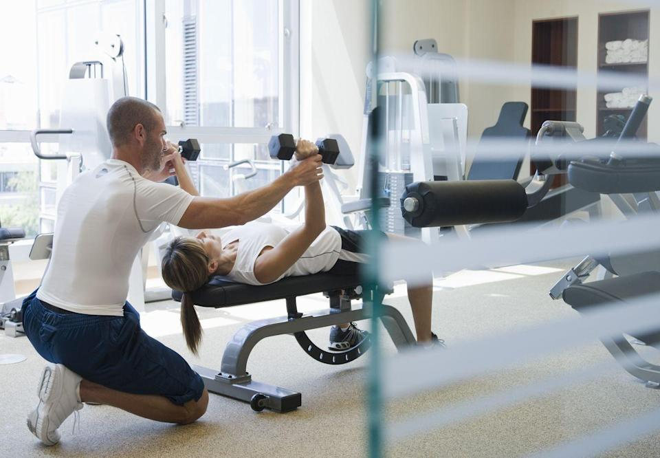 """<p>You can look at the pictures on the side of the machines at the gym for instructions on how to use them, but you're on your own with free weights. Yes, there's a mirror to help you watch your form, but you might still come home feeling unexpectedly sore...or worse. """"A surprising or unexpected benefit of working with a personal trainer is that they significantly decrease the likelihood of injury,"""" says Kelly Bryant, a certified yoga instructor and personal trainer. """"Personal trainers will teach their clients the correct form and fix any incorrect movement that may have previously made them prone to injury."""" Training is expensive, but the price can outweigh the cost of an injury. </p>"""