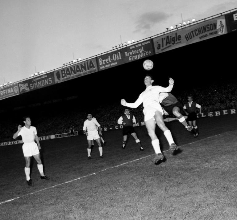 First to the ball: Raymond Kopa of Real Madrid holds off Michel Leblond of Reims in the first European Cup final in Paris in June 1956