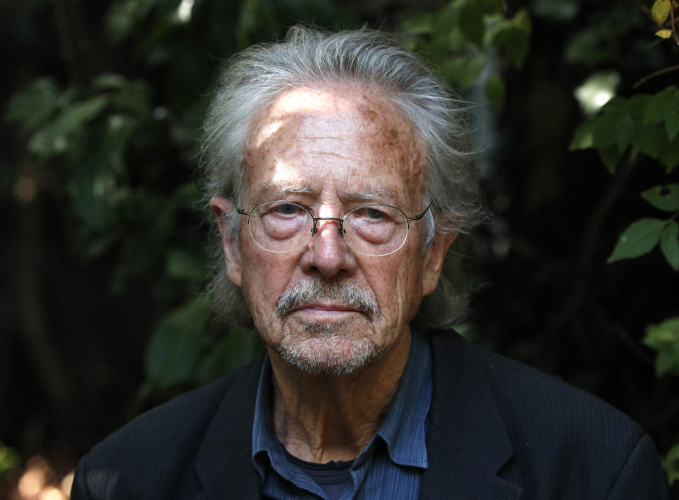 Austrian author Peter Handke sits in his garden at his house in Chaville near Paris, Thursday, Oct. 10, 2019. Handke was awarded the 2019 Nobel Prize in literature earlier Thursday. (AP Photo/Francois Mori)
