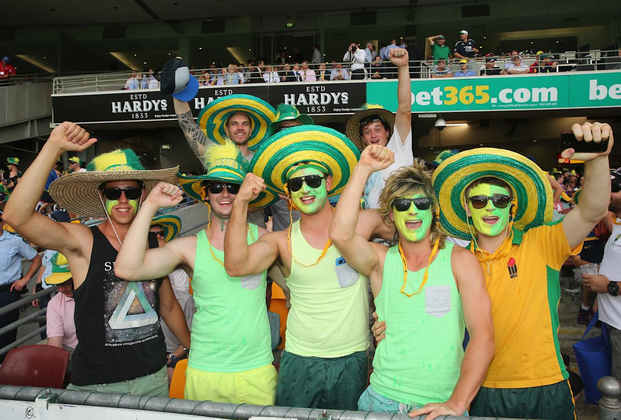 BRISBANE, AUSTRALIA - NOVEMBER 23:  Australian fans show their support during day three of the First Ashes Test match between Australia and England at The Gabba on November 23, 2013 in Brisbane, Australia.  (Photo by Scott Barbour/Getty Images)