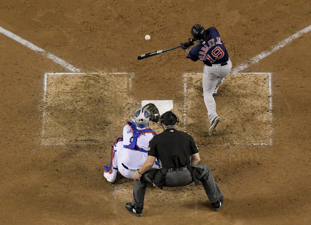 Boston Red Sox's Jackie Bradley Jr. hits a solo home run during the eighth inning in Game 3 of the World Series baseball game against the Los Angeles Dodgers on Friday, Oct. 26, 2018, in Los Angeles. (AP Photo/Mark J. Terrill)