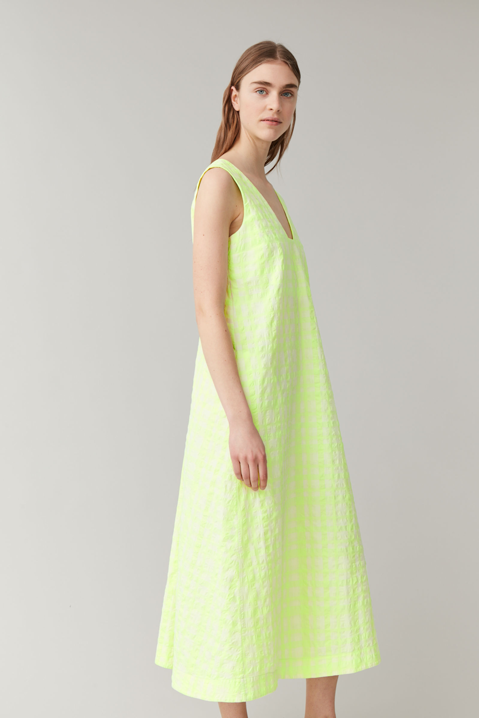 """<h2>Two Words: House Dresses</h2> <br>When in the comfort of your own home, you might be tempted to just wear leggings and a baggy T-shirt, or a matching sweatsuit. May we suggest turning to house dresses next time? Flowy and lightweight, these frocks feel like you're wearing nothing at all.<br><br><strong>COS</strong> Lyocell-Linen Long Seersucker Checked Dress, $, available at <a href=""""https://go.skimresources.com/?id=30283X879131&url=https%3A%2F%2Fwww.cosstores.com%2Fen_usd%2Fwomen%2Fwomenswear%2Fdresses%2Fproduct.lyocell-linen-long-seersucker-checked-dress-yellow.0888424001.html"""" rel=""""nofollow noopener"""" target=""""_blank"""" data-ylk=""""slk:COS"""" class=""""link rapid-noclick-resp"""">COS</a><br>"""