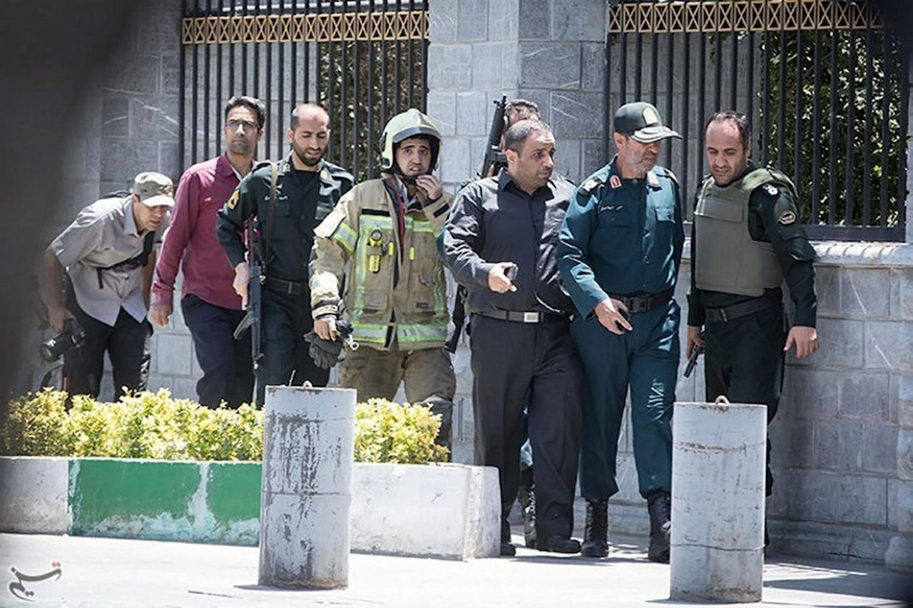 <p>Members of Iranian forces are seen during an attack on the Iranian parliament in central Tehran, Iran, June 7, 2017. (Photo: Tasnim News Agency/Handout via Reuters) </p>
