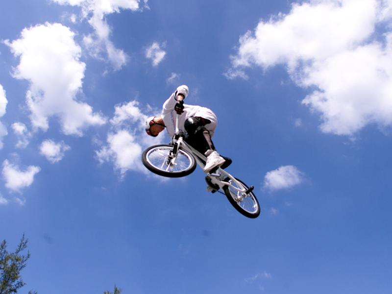 The freestyle rider held several titles during his life, including for landing a double flair and the longest power-assisted bicycle flip: Getty