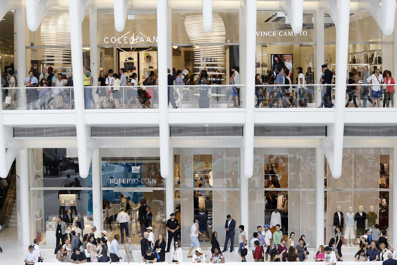 In this Aug. 16, 2016 photo, shoppers walk on two levels of the newly opened Westfield World Trade Center mall in New York. Fifteen years after the Sept. 11th attacks, downtown New York has been reborn, not just with the construction of One World Trade, but with a host of attractions both somber and vibrant, including the 9/11 Memorial and Museum, two retail malls, new hotels and restaurants. (AP Photo/Mark Lennihan)