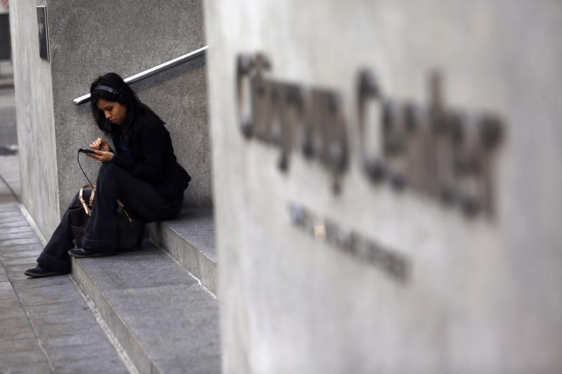A woman uses a smartphone in the financial district in San Francisco