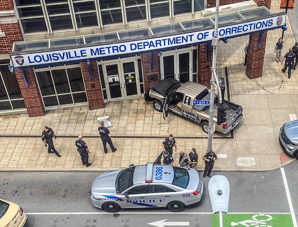 Officers arrest the driver of a pickup that crashed into the Louisville Metro Department of Corrections on Tuesday, July 13, 2021.