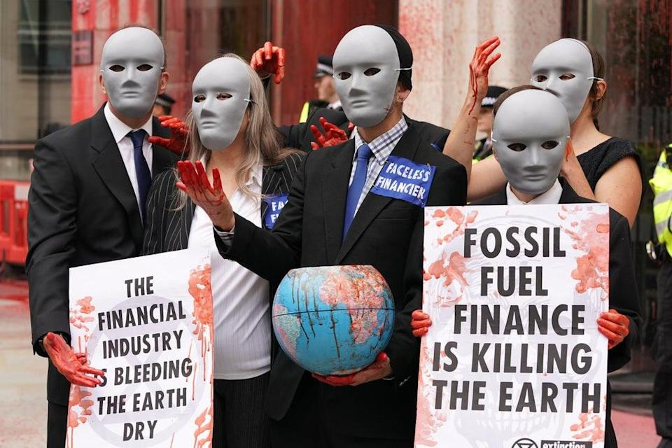 Extinction Rebellion demonstrators outside the Guildhall (Kirsty O'Connor/PA) (PA Wire)