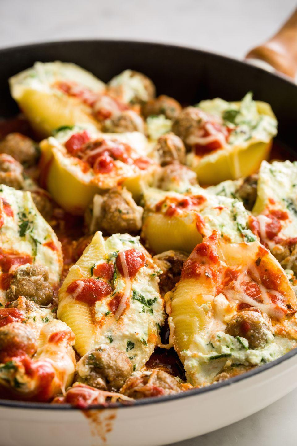 """<p>Mini turkey meatballs take these meaty shells to the next level.</p><p><span>Get the recipe from </span><a href=""""https://www.redbookmag.com/cooking/recipe-ideas/recipes/a45726/spinach-stuffed-shells-with-mini-turkey-meatballs-recipe/"""" rel=""""nofollow noopener"""" target=""""_blank"""" data-ylk=""""slk:Delish"""" class=""""link rapid-noclick-resp"""">Delish</a><span>.</span><br></p><p><span><strong><a class=""""link rapid-noclick-resp"""" href=""""https://www.amazon.com/Creuset-Signature-Handle-Skillet-4-Inch/dp/B00B4UOTBQ/?tag=syn-yahoo-20&ascsubtag=%5Bartid%7C10063.g.34933194%5Bsrc%7Cyahoo-us"""" rel=""""nofollow noopener"""" target=""""_blank"""" data-ylk=""""slk:BUY NOW"""">BUY NOW</a><em> Le Creuset Cast-Iron 12"""" Skillet, $200, amazon.com</em></strong><br></span></p>"""