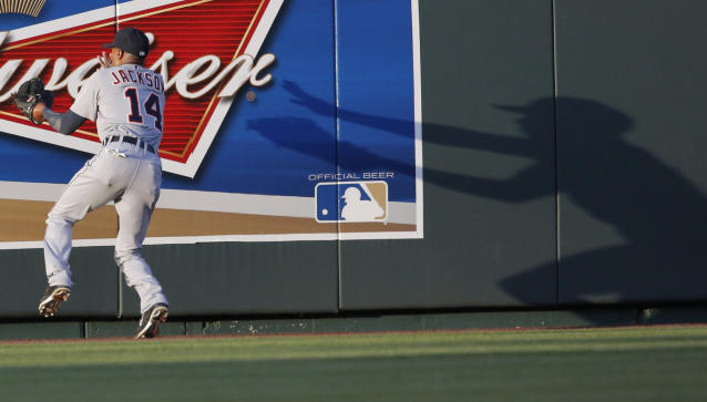 Detroit Tigers center fielder Austin Jackson (14) catches a fly ball hit by Kansas City Royals' Alex Gordon during the fourth inning of a baseball game in Kansas City, Mo., Saturday, May 3, 2014. (AP Photo/Orlin Wagner)