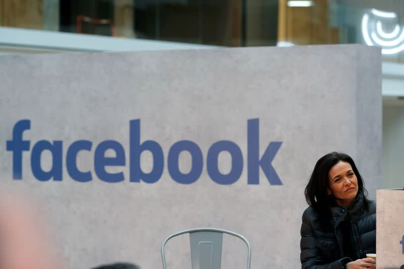 FILE PHOTO: Sheryl Sandberg, chief operating officer of Facebook, listens to a speeches during a visit in Paris