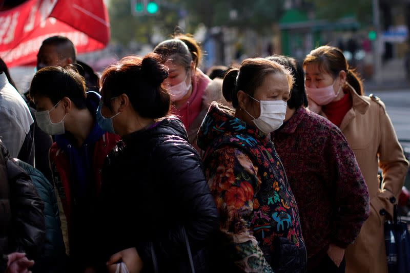 People wearing masks are seen in downtown Shanghai