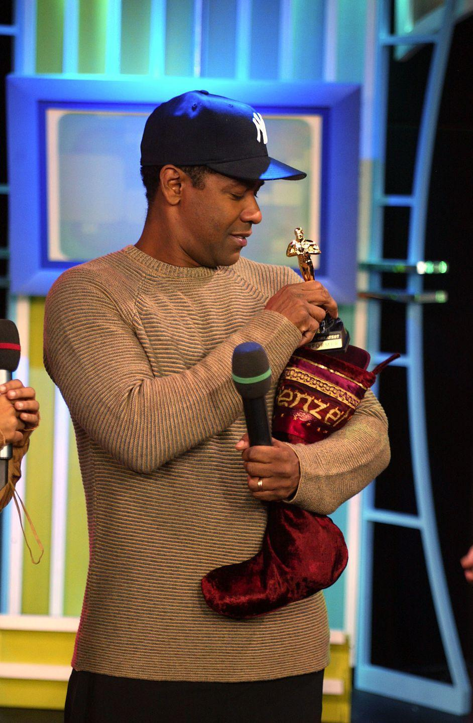 <p>I'm sure Denzel was just as honored to receive this tiny <em>TRL</em> Oscar as he was to receive his real Oscars!</p>