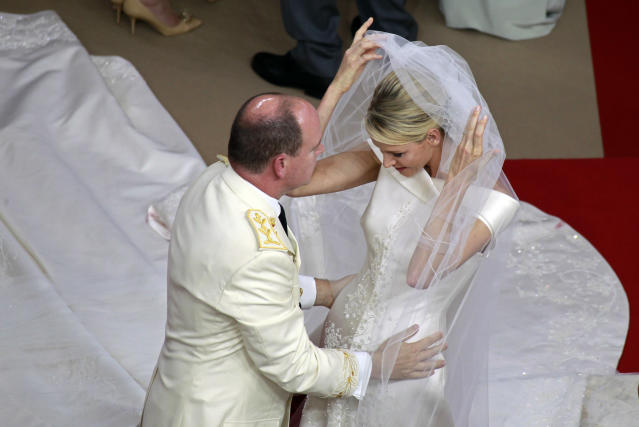 Princess Charlene raises the veil before the kiss with Monaco's Prince Albert II during their religious wedding ceremony at the Palace in Monaco July 2, 2011. REUTERS/Eric Gaillard (MONACO - Tags: ENTERTAINMENT ROYALS) (MONACO ROYAL WEDDING)