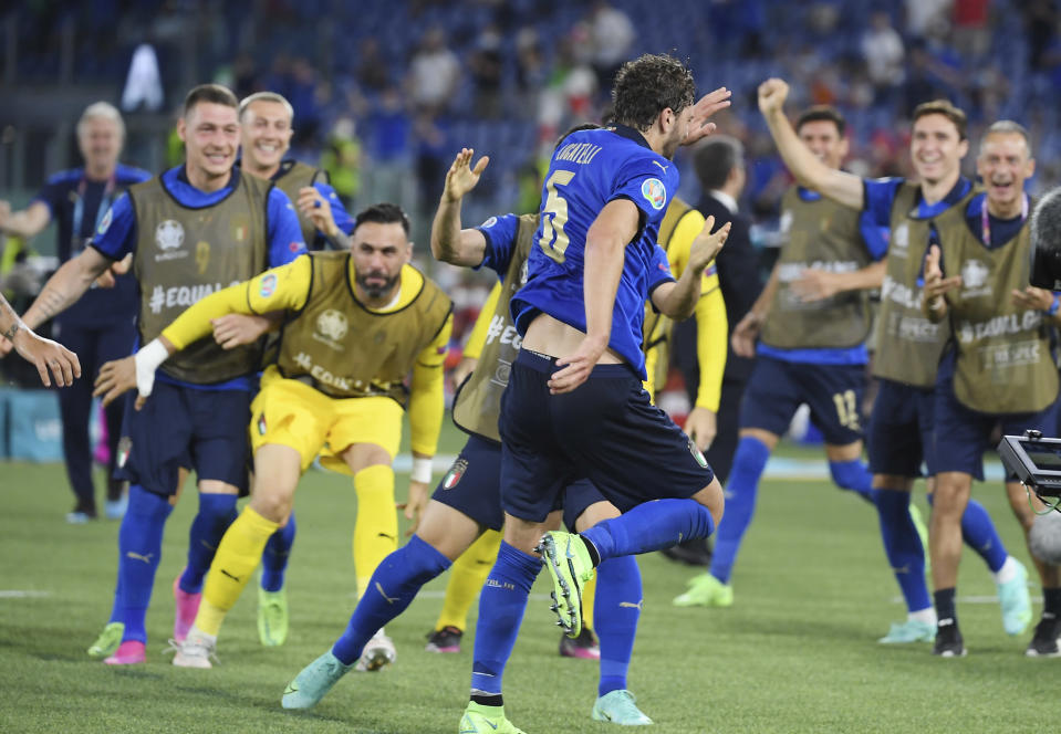 Italy's Manuel Locatelli celebrates with his teammates after scoring his side's opening goal during the Euro 2020 soccer championship group A match between Italy and Switzerland at Olympic stadium in Rome, Wednesday, June 16, 2021. (Ettore Ferrari, Pool via AP)