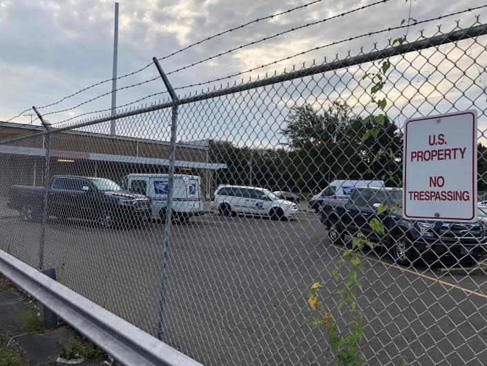 U.S. Postal Service vehicles sit in a parking lot of a facility where authorities said a postal employee fatally shot two workers before dying from a self-inflicted gunshot Wednesday, Oct. 13, 2021 in Memphis, Tenn. The U.S. Postal Inspection service and other federal agencies are investigating Tuesday's shooting, which took place at a postal annex located in a historic Memphis neighborhood. The victims and the shooter have not been identified. (AP Photo/Adrian Sainz)