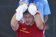 Pablo Carreno Busta, of Spain, tries to keep cool between games against Dominik Koepfer, of Germany, during the third round of the tennis competition at the 2020 Summer Olympics, Wednesday, July 28, 2021, in Tokyo, Japan. (AP Photo/Seth Wenig)
