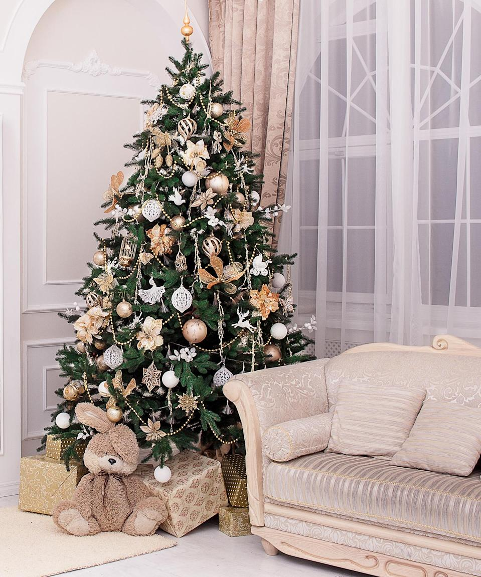 <p>As you set up the tree, don't forget the oldie, but goodie trick of placing a tree bag beneath your Frasier Fir (or evergreen of your choice) to make future cleanup easier. Keep it covered with the tree skirt and no one will be the wiser (until disposal day comes around!).</p> <p>Keep the tree well-watered (it needs about a gallon a day) to keep it healthy and to prevent more needles from falling. Once you've got it all set up, if those vintage ornaments seem a little dull, revive their shine by applying a coat of clear or glittery nail polish. Voila--shiny as new!</p>