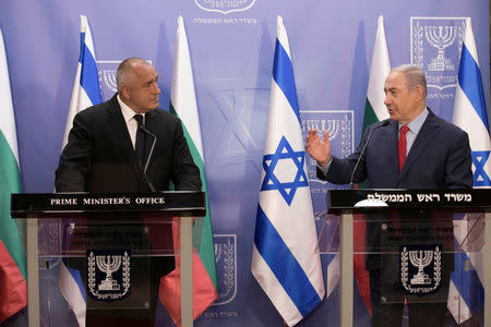 Israeli Prime Minister Benjamin Netanyahu gestures as he stands next to Bulgarian Prime Minister Boyko Borissov during a meeting at the prime minister's office in Jerusalem, June 13, 2018. Abir Sultan/Pool via Reuters