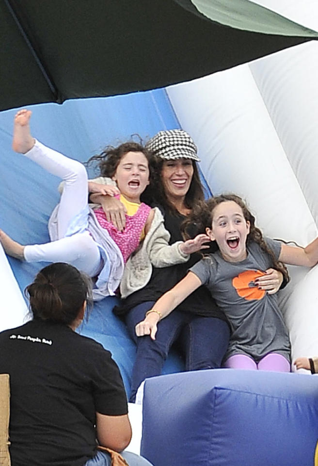 "Instead of just waiting at the bottom of the slide for her daughters Jagger, 4, and Poet, 7, former ""Punky Brewster"" star Soleil Moon Frye decided to go along for the ride! (10/9/2012)<br><div style=""display:none;"" class=""skype_pnh_menu_container""><div class=""skype_pnh_menu_click2call""><a class=""skype_pnh_menu_click2call_action"">Call</a></div><div class=""skype_pnh_menu_click2sms""><a class=""skype_pnh_menu_click2sms_action"">Send SMS</a></div><div class=""skype_pnh_menu_add2skype""><a class=""skype_pnh_menu_add2skype_text"">Add to Skype</a></div><div class=""skype_pnh_menu_toll_info""><span class=""skype_pnh_menu_toll_callcredit"">You'll need Skype Credit</span><span class=""skype_pnh_menu_toll_free"">Free via Skype</span></div></div>"