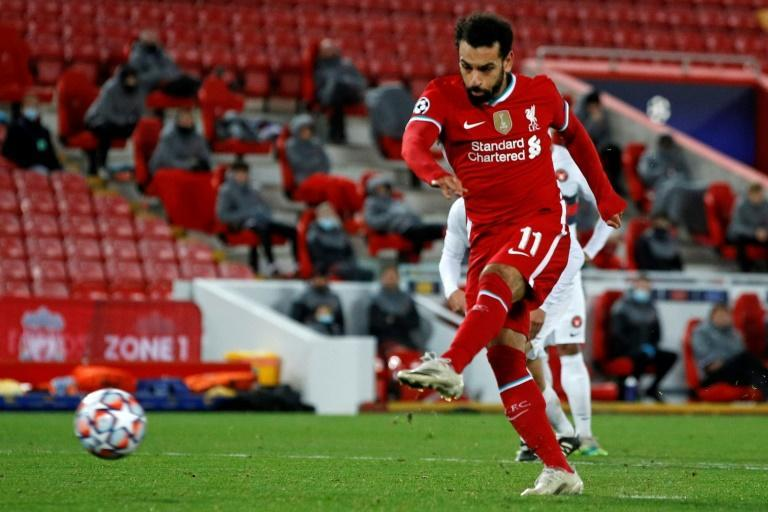 Liverpool's Mohamed Salah scores from the penalty spot against Midtjylland