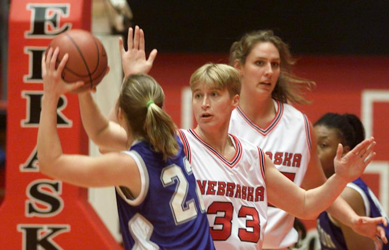 CORRECTS TO BASKETBALL, NOT VOLLEYBALL - In a Dec. 12, 1999 photo,  Nebraska's Charlie Rogers (33), guards Creighton's Corey Sweeney (22) during a women's basketball match in Lincoln, Neb.  Rogers, who told police she was the victim of a vicious hate crime in July, 2012,  was charged with making a false report Tuesday, Aug. 21, 2012 and pleaded not guilty to the misdemeanor charge. Authorities issued an arrest warrant for Rogers Tuesday morning. (AP Photo/Lincoln Journal Star, William Lauer)