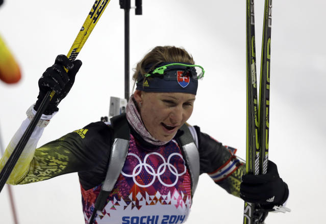 Slovakia's Anastasiya Kuzmina smiles after completing the women's biathlon 7.5k sprint, at the 2014 Winter Olympics, Sunday, Feb. 9, 2014, in Krasnaya Polyana, Russia. (AP Photo/Kirsty Wigglesworth)
