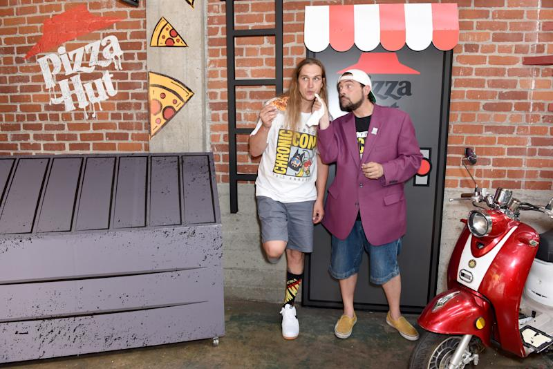 SAN DIEGO, CALIFORNIA - JULY 18: (L-R) Jason Mewes and Kevin Smith of 'Jay and Silent Bob' attend the Pizza Hut Lounge at 2019 Comic-Con International: San Diego on July 18, 2019 in San Diego, California. (Photo by Presley Ann/Getty Images for Pizza Hut)