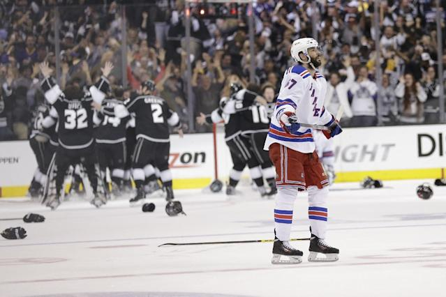 New York Rangers left wing Benoit Pouliot looks on after losing to the Los Angeles Kings during overtime in Game 5 of the NHL Stanley Cup Final series Friday, June 13, 2014, in Los Angeles. (AP Photo/Gregory Bull)