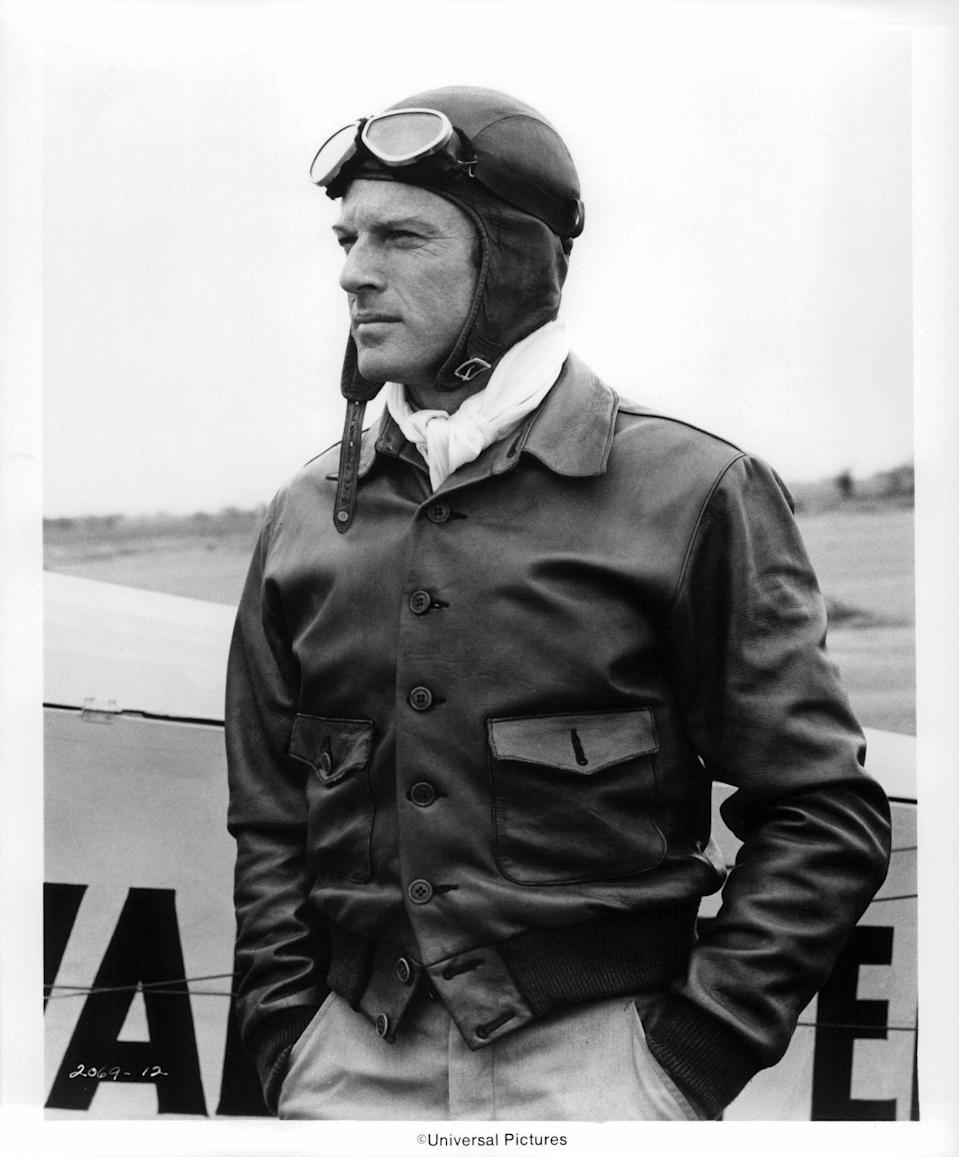 <p>Robert Redford wears a pilot outfit for a scene in <em>The Great Waldo Pepper </em>in 1975. </p>