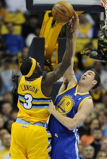 Golden State Warriors guard Klay Thompson, right, blocks a shot by Denver Nuggets point guard Ty Lawson, left, in the first quarter of Game 1 in the first round of the NBA basketball playoffs on Saturday, April 20, 2013, in Denver. (AP Photo/Chris Schneider)