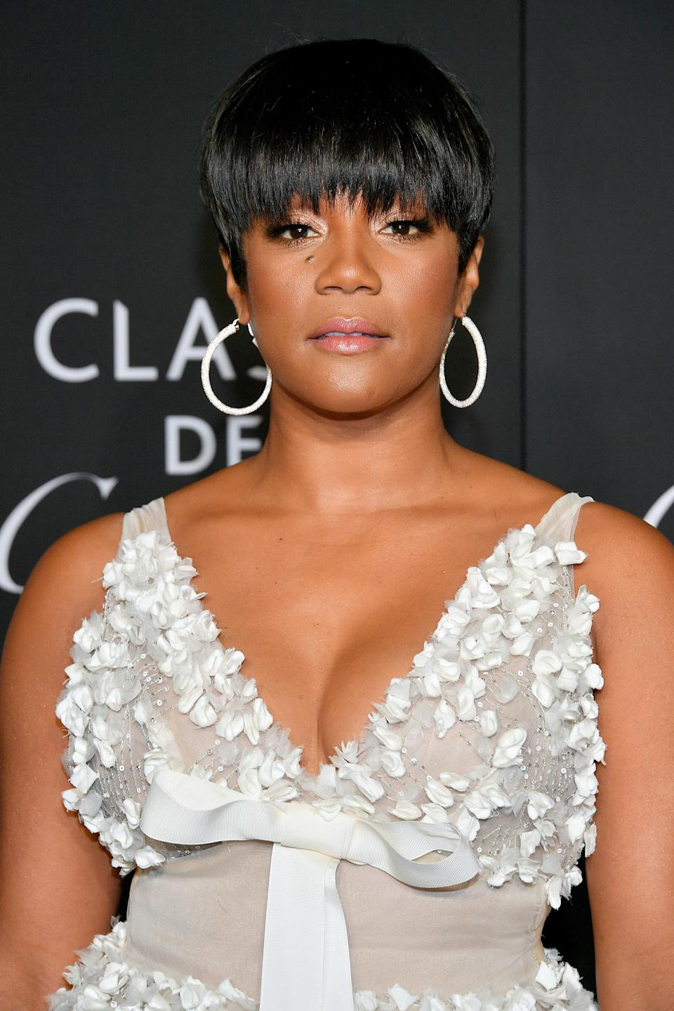 This chic pixie cut is sleek, choppy, and curled under to perfection. The longer length at the temples frames Haddish's face wonderfully.