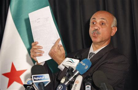 Abdeltawwab Shahrour, head of the forensic medicine committee in Aleppo, shows forensic reports, during a news conference in Istanbul September 10, 2013. REUTERS/Murad Sezer
